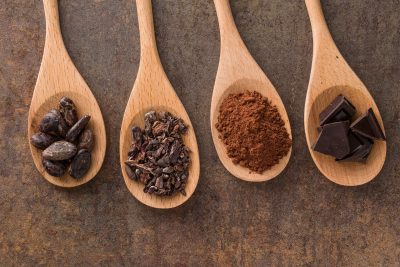cocoa-and-dark-chocolate-in-wooden-spoons